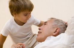 Grandpa 3. Adult senior play about with his grandson Royalty Free Stock Photos