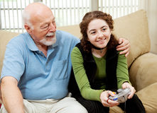 Grandpa Bonds with Teen Royalty Free Stock Photo