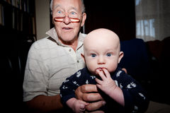 Grandpa and Clever Grandson Stock Photos