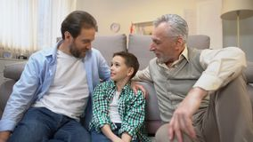 Grandpa and dad sharing experience with preteen boy, family bounds, togetherness. Stock footage stock video