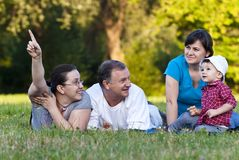 Grandpa, daughters and niece on grass Royalty Free Stock Photos