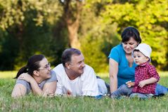 Grandpa, daughters and niece on grass Stock Image