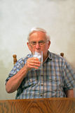 Grandpa drinks ice water Royalty Free Stock Image