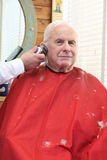 Grandpa gets a haircut Royalty Free Stock Photo