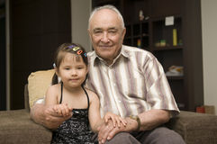 Grandpa and grand daughter Royalty Free Stock Photo