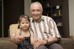 Grandpa and grand daughter Royalty Free Stock Photo