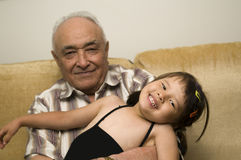 Grandpa and grand daughter Royalty Free Stock Photography
