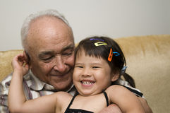 Grandpa and grand daughter Stock Photos