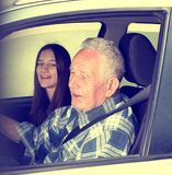 Grandpa with granddaughter in car royalty free stock photos