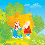 Grandpa and grandma. Old man and woman in traditional peasant clothes in front of their log village house Stock Images