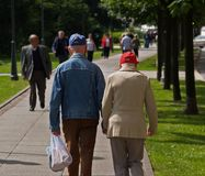 Grandpa And Grandma Holding Hands. Very old couple (husband and wife) holding hands while walking down the street Stock Image