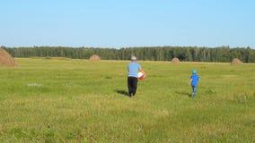 Grandad and grandchild in the countryside