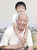 Grandpa and grandson. Having fun at home royalty free stock photos