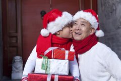 Grandpa and grandson holding Christmas Gifts Stock Photography