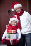 Grandpa and grandson holding Christmas Gifts Stock Photo