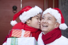 Grandpa and grandson holding Christmas Gifts Royalty Free Stock Photos