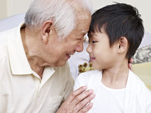 Grandpa and grandson. Grandpa talking to grandson royalty free stock photo