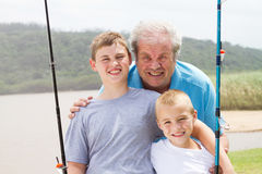 Grandpa grandsons fishing Stock Image