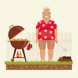 Grandpa grilling outside Royalty Free Stock Images