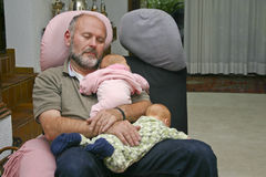 Grandpa and his grandchildren fell asleep Stock Images