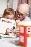 Grandpa and his grandson playing stock photography