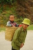 Grandpa and his little son. Grandfather Hmong and her small son in the cart. The road is long and the baby is tired Stock Image