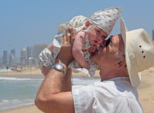 Grandpa is holding a little granddaughter Stock Photography