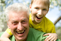 Grandpa keeps his grandson Royalty Free Stock Photos