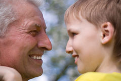 Grandpa keeps his grandson Royalty Free Stock Photography