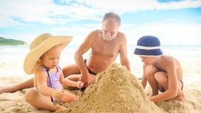 Grandpa Little Girl Boy Sit Make Sand Heap on Beach by Surf stock footage