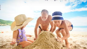 Grandpa Little Girl Boy Squat Make Sand Heap on Beach by Surf stock footage