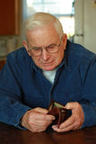 Grandpa looking in empty wallet Royalty Free Stock Images