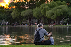 Grandpa and nephew relaxing in chatuchak park Stock Image