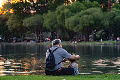 Grandpa and nephew relaxing in chatuchak park Royalty Free Stock Images