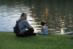Grandpa and nephew relaxing in chatuchak park Stock Photography