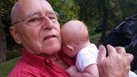 Grandpa Patting Baby on Back Royalty Free Stock Photos