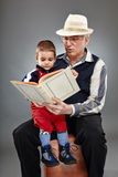 Grandpa reading fairytales to toddler Stock Images