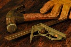 Grandpa`s tools, hammer, glove, level. stock photos