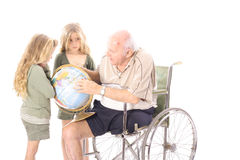 Grandpa showing his grandchildren the globe. Isolated on white Royalty Free Stock Images