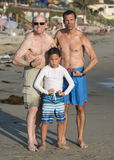 Grandpa, son, and grandson flexing thier muscles on Venice Beach Royalty Free Stock Images