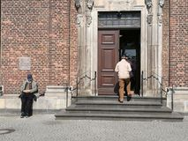 A grandpa standing outside the church to take rest Stock Image
