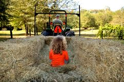 Grandpa taking granddaughter on a hayride Royalty Free Stock Images