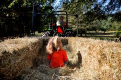 Grandpa taking granddaughter on a hayride stock image