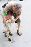 Grandpa teaches grandson to write Stock Image