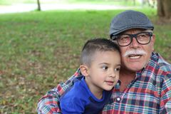 Grandpa telling stories to grandson.  stock photo