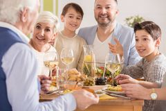 Grandpa telling a story. To his family at the dinner royalty free stock images