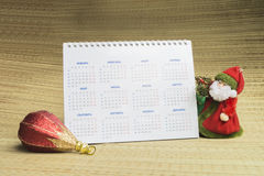 Grandparent Frost,calendar and toy. For fir tree on beige background Royalty Free Stock Images