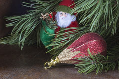 Grandparent Frost with toy cost(stand)s under fir tree Royalty Free Stock Images