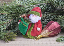 Grandparent Frost with toy for fir tree. On background of the green branches with needle Royalty Free Stock Photography