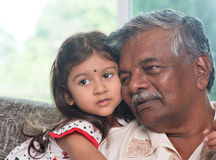 Grandparent and grandchild close up face. Portrait Indian family at home. Grandparent and grandchild close up face. Asian people living lifestyle. Grandfather stock image